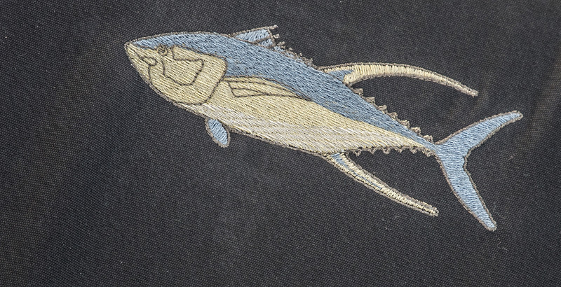 • Fort Pierce City Marina<br /> • Embroidery of fish on a cloth sitting on a boat