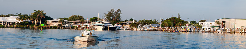 This was a Panorama photo taken when leaving the dock. I was hand-holding my DSLR while on the boat. These 4 photographs were stitched together using Photoshop CS6.