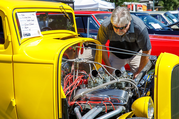 Ken DeMarco car owner enjoying the other cars looking at engine