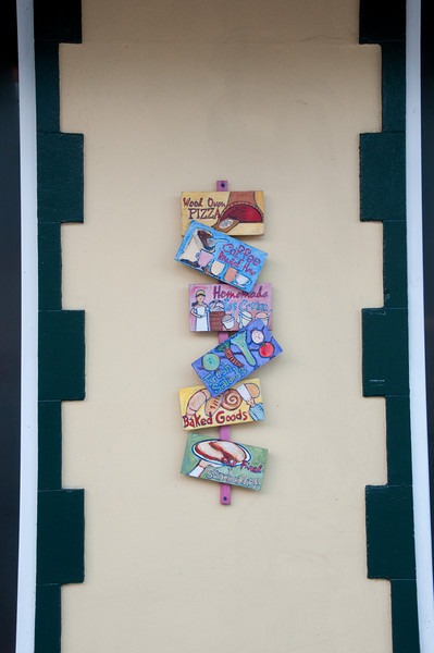 A series of Cocoa Village advertising signs
