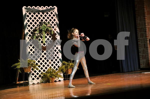 """-Messenger photo by Joe Sutter<br /> <br /> Macy McAllister performs a hip-hop dance to """"Watch Me"""" during the Little Lassie competition Sunday afternoon."""