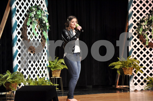 "-Messenger photo by Joe Sutter<br /> <br /> The Miss Shamrock pageant isn't all formal dresses. Brittany Poeppe wears jeans and a leather jacket as she performs her vocal solo ""Valerie"" for the talent portion of Emmetsburg's Miss Shamrock pageant Sunday afternoon."