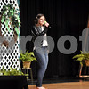 "-Messenger photo by Joe Sutter  The Miss Shamrock pageant isn't all formal dresses. Brittany Poeppe wears jeans and a leather jacket as she performs her vocal solo ""Valerie"" for the talent portion of Emmetsburg's Miss Shamrock pageant Sunday afternoon."