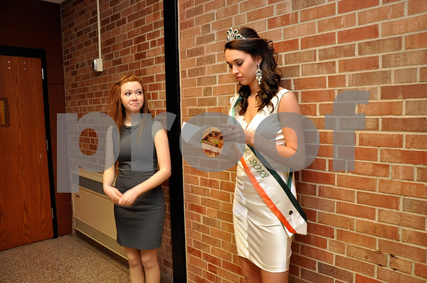 -Messenger photo by Joe Sutter<br /> <br /> Miss Shamrock contestant Katlyn Moore, left, waits backstage with 2013's Miss Shamrock, Casey Sievert, prior to winning the crown herself at Sunday's pageant. Moore would win the judges over with her performance in the pre-pageant interview, formal wear and casual wear segments, pointe dancing talent and response to a question on-stage.