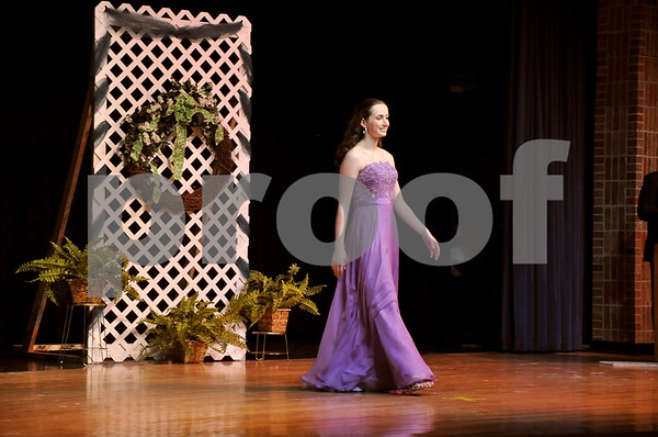 -Messenger photo by Joe Sutter<br /> <br /> Elizabeth Naviaux takes the stage during the formal wear portion of the Miss Shamrock pageant.