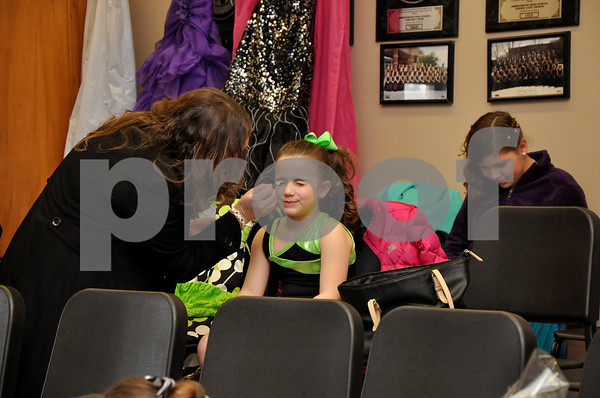 -Messenger photo by Joe Sutter<br /> <br /> Holly Harnden helps her daughter Macy Harnden, 7, put on makeup before the Little Miss Shamrock competition Sunday afternoon.