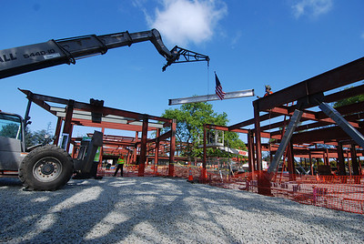 The final beam is lifted into place.