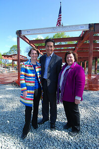 Alison Cormack, Mayor Sid Espinosa, and Susie Thom in front of the last beam.