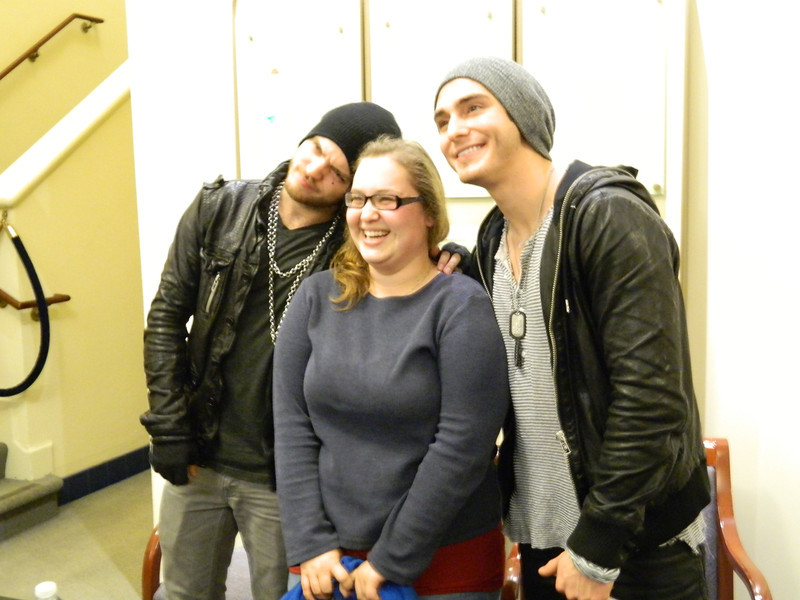 "Alexander DeLeon and Alex Marshall of the band ""The Cab"" pose with a fan."