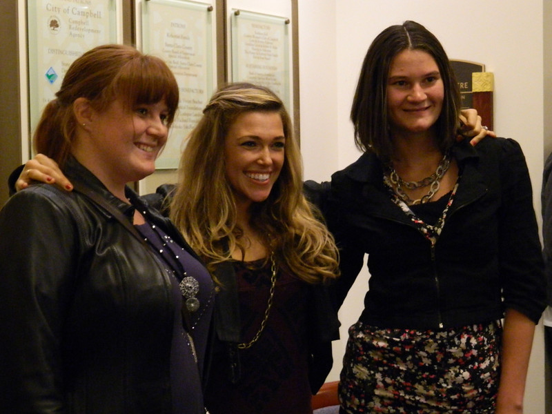 Singer Rachel Platten poses with fans.