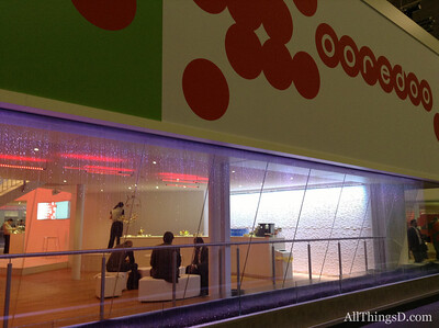 """Among the more elaborate meeting rooms, Middle East carrier Qtel Group spared little expense touting its new name Ooredoo, which means """"I want."""""""