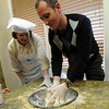 "Barbara Brown helps  Amnon Govrin with the dough mixing.<br /> The Model Matzah Bakery was brought to Boulder by Chabad Lubavitch of Boulder County. The bakery is an educational experience for the entire family to learn about the story and art of making matzah.<br /> For more photos and a video, go to  <a href=""http://www.dailycamera.com"">http://www.dailycamera.com</a>.<br /> Cliff Grassmick / March 14, 2010"