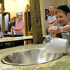 "Yossi Scheiner, 6, adds the flour to make matzah.<br /> The Model Matzah Bakery was brought to Boulder by Chabad Lubavitch of Boulder County. The bakery is an educational experience for the entire family to learn about the story and art of making matzah.<br /> For more photos and a video, go to  <a href=""http://www.dailycamera.com"">http://www.dailycamera.com</a>.<br /> Cliff Grassmick / March 14, 2010"