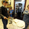 "Lindsey Greene has matzah hot out of the oven.<br /> The Model Matzah Bakery was brought to Boulder by Chabad Lubavitch of Boulder County. The bakery is an educational experience for the entire family to learn about the story and art of making matzah.<br /> For more photos and a video, go to  <a href=""http://www.dailycamera.com"">http://www.dailycamera.com</a>.<br /> Cliff Grassmick / March 14, 2010"
