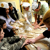 "Barbara Brown, center, adds flour to the dough as the group works.<br /> The Model Matzah Bakery was brought to Boulder by Chabad Lubavitch of Boulder County. The bakery is an educational experience for the entire family to learn about the story and art of making matzah.<br /> For more photos and a video, go to  <a href=""http://www.dailycamera.com"">http://www.dailycamera.com</a>.<br /> Cliff Grassmick / March 14, 2010"