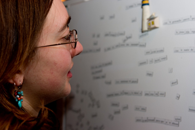 Rachel examining the French Magnetic Poetry.