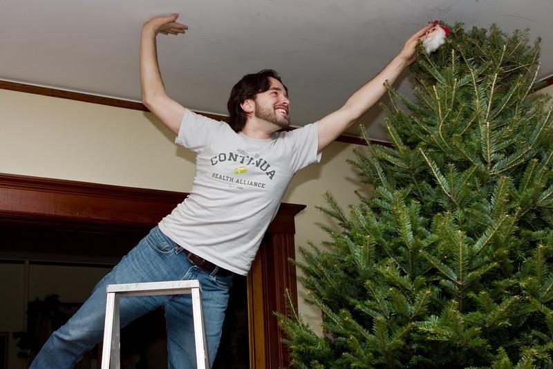 Nathan placing the Santa.