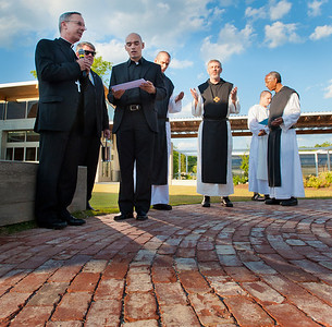 Atlanta Auxiliary Bishop Luis R. Zarama, left, blesses the grounds at the Monastic Heritage Center, now open at the Monastery of the Holy Spirit, Conyers. The monastery's abbot, Dom Francis Michael Stiteler, third from right, prays along with the bishop.  (Page 15, May 12, 2011 issue)