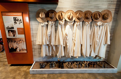 A row of hats, robes and boots illustrates the simple lifestyle of the monks at the Monastery of the Holy Spirit. The exhibit at the Monastic Heritage Center includes artifacts of the monastery's history, including items from the 21 Trappist monks who traveled from Gethsemani Abbey in Kentucky in 1944 to establish a new community in Georgia.  (Page 17, May 12, 2011 issue)