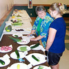 Ken de la Bastide | The Herald Bulletin<br /> Pat Behm provides some pointers to Paige Dupps during the judging of<br /> gardening at the 4-H Fair.
