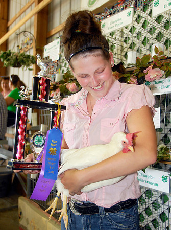 John P. Cleary | The Herald Bulletin<br /> Logan Miller, 15, is all smiles after her bird won champion Large Foul during the Poultry Show Monday at the Madison County 4-H Fair.