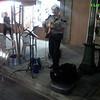 Street musician on sidewalk