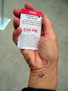 To get onto the ship, we had to provide identification, have our wrists stamped with a little starfish (which was examined by about 42 different people between the stamping station and the gangway to the ship), and hold onto our time-specific tickets.  (And, oh yeah, ever tried taking a photo of your right hand?)