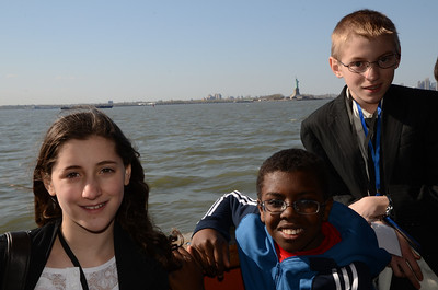 Group with the Statue of Liberty in the background