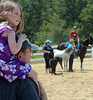 Pat Kelly holds his daughter alice ,3, on his shoulders as they watch a Parade of Horse Breeds during the Montgomery County 4-H Fair in Skippack Township on Saturday August 9,2014. Photo by Mark C Psoras