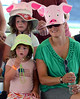 A family sports some pig hats as they watch the Celebrity Goat Dressing Contest during the Montgomery County 4-H Fair in Skippack Township on Saturday August 9,2014. Photo by Mark C Psoras