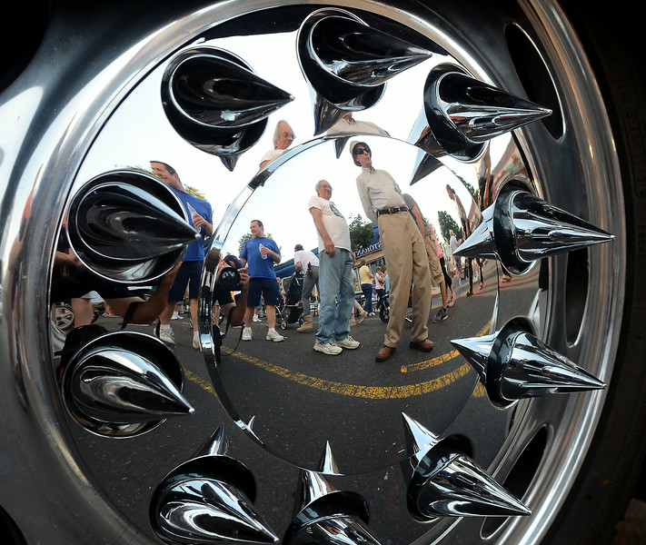 Crowds are reflected in a spiked hub cap as classic cars are inspected displayed along York Rd for the 22nd Annual Moonlight Memories Car Show in Hatboro presented by the greater Hatboro Chamber of Commerce  on Saturday July 26,2014. Photo by Mark C Psoras/The Reporter