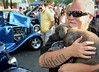 Mike Lupinetti holds his puppy Lucia as classic cars are inspected by a packed crowd along York Rd for the 22nd Annual Moonlight Memories Car Show in Hatboro presented by the greater Hatboro Chamber of Commerce  on Saturday July 26,2014. Photo by Mark C Psoras/The Reporter