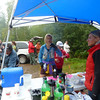 Susan Donnelly grabs a cup of liquid.  She is now about 84 miles into her 10th 100 mile finish on this course.