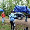 Joanne helps set up aid station tent.  The Cramer Road aid station is 77.2 miles into the Superior Sawtooth 100 Mile Run, and is the starting line for the Moose Mountain Marathon.