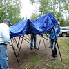 Joanne & Paul help set up tent for aid station.  We were glad to have tent later, since it poured all night.<br /> Sept. 10, 2010,  Moose Mountain Marathon.