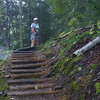 Joanne waits for me to join her at the top of the steps.  There are many such staircases along the Superior Hiking Trail.<br /> Sept. 2010.