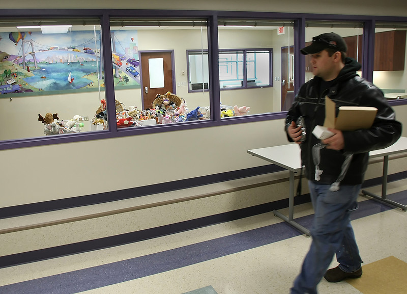 While putting finishing touches for its grade opening workman Jason Barr walks by viewing room at the Sandra L. Jackson Birth Care Unit.