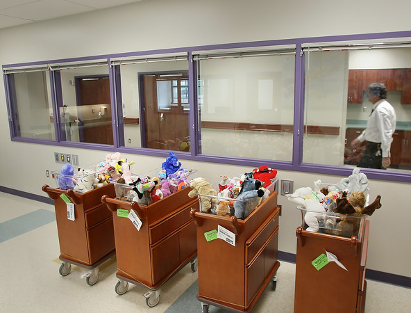 At the Sandra L. Jackson Birth Care Unit newborn viewing room Hillcrest Hospital employee Vincent Frantom walks past some of the over 300 beanie babies that were donated by Jackson for use in the unit.