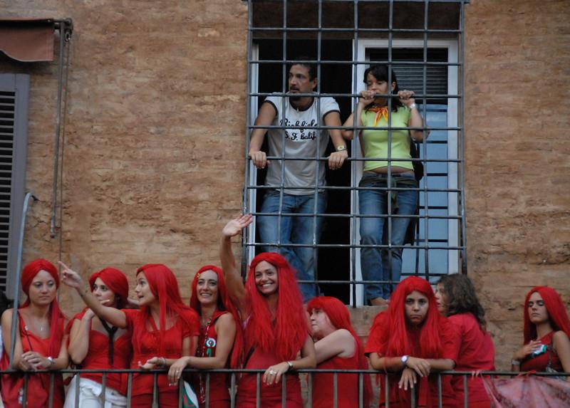 Girls from contrada watching trial run of palio