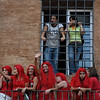Girls from contrada watching trial run of palio