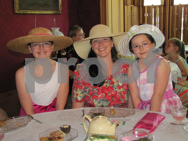 Alex and Lizzy Tiernan and their mother, Chris Tiernan, donned their bonnets at the Mother/Daughter Tea held at the historic Vincent House in Fort Dodge.