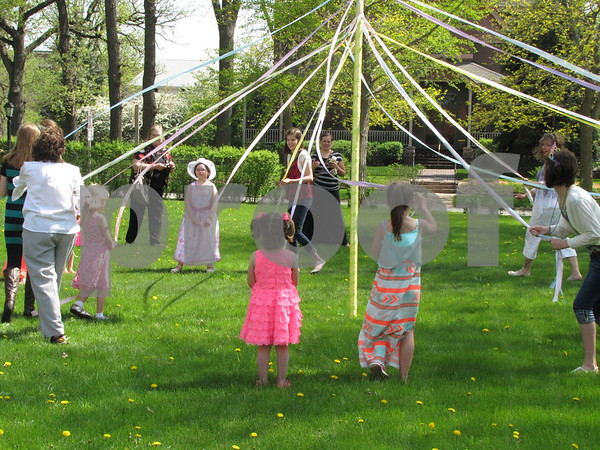 Beautiful dresses and laughter adorned the lawn at the historic Vincent House as children danced around the May pole at the Mother/Daughter Tea.