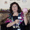 A Women's Federation for World Peace leader explains about piggy banks with a special purpose.