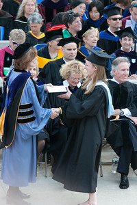 Receiving her diploma.