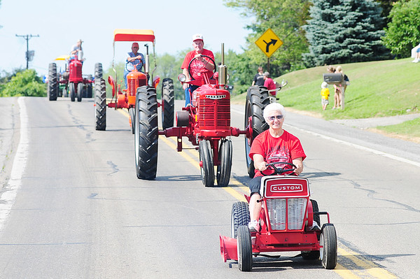 Nancy Jaeger of New Wilmington leads a group of tractors in the parade with her Sears Custom 600 from the 1950's.