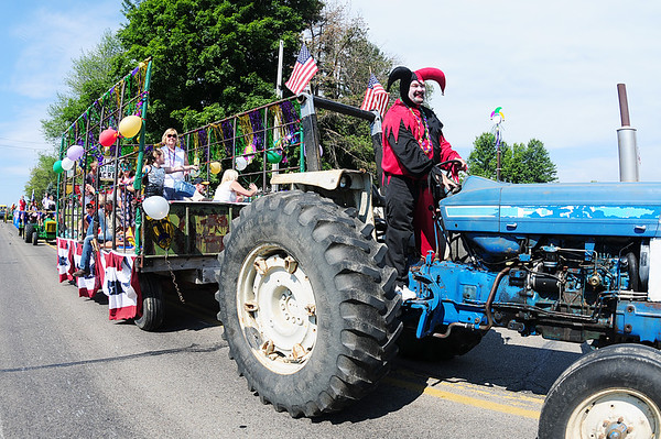 The marti gras themed tractor and trailor of Clark's Acres moves through the parade Saturday morning.