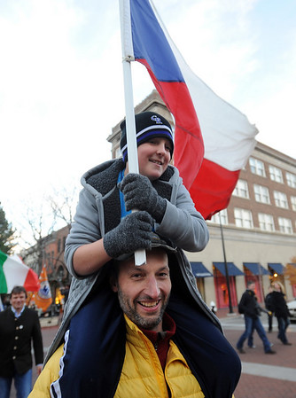 """Travis Bicknell, holding the Czech flag, is carried by Czech mountain guide Josef Simunek during the parade down Pearl Street on Sunday.<br /> The American Mountain Guides Association, based in Boulder, and the International Federation of Mountain Guides Association, had a joint meeting in Boulder. Over 300 members from 17 different countries attended.<br /> For more photos and a video of the parade, go to  <a href=""""http://www.dailycamera.com"""">http://www.dailycamera.com</a>.<br /> Cliff Grassmick / November 14, 2010"""