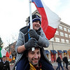 "Travis Bicknell, holding the Czech flag, is carried by Czech mountain guide Josef Simunek during the parade down Pearl Street on Sunday.<br /> The American Mountain Guides Association, based in Boulder, and the International Federation of Mountain Guides Association, had a joint meeting in Boulder. Over 300 members from 17 different countries attended.<br /> For more photos and a video of the parade, go to  <a href=""http://www.dailycamera.com"">http://www.dailycamera.com</a>.<br /> Cliff Grassmick / November 14, 2010"