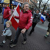 "Teagan Malcom, holds the Austrian flag with help from mountain guide, Hans Bergmann, during the Pearl Street parade on Sunday.<br /> The American Mountain Guides Association, based in Boulder, and the International Federation of Mountain Guides Association, had a joint meeting in Boulder. Over 300 members from 17 different countries attended.<br /> For more photos and a video of the parade, go to  <a href=""http://www.dailycamera.com"">http://www.dailycamera.com</a>.<br /> Cliff Grassmick / November 14, 2010"