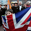 "Oz Alkaitis, 8, holds the flag of Great Britain  while listening to guest speakers. He was part of a parade down Pearl Street of mountain guides Sunday evening. Guides from Northern Italy are behind him.<br /> The American Mountain Guides Association, based in Boulder, and the International Federation of Mountain Guides Association, had a joint meeting in Boulder. Over 300 members from 17 different countries attended.<br /> For more photos and a video of the parade, go to  <a href=""http://www.dailycamera.com"">http://www.dailycamera.com</a>.<br /> Cliff Grassmick / November 14, 2010"
